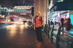 Handsome bearded man standing roadside street while traveling at. Night in bangkok city thailand background stock images