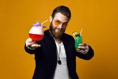 Cheerful bearded young man holding cocktail and smile to camera isolated stock photos