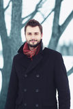 Handsome bearded man with stylish hairstyle in black coat Stock Image