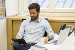 Handsome bearded man working in office on computer Stock Photo