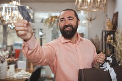 Bearded mature man shopping at home goods store royalty free stock image