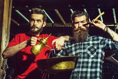 Bearded barber men with razor royalty free stock photography