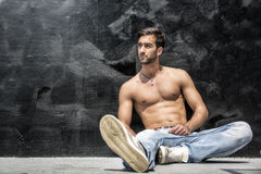 Handsome bearded shirtless young man sitting Stock Image