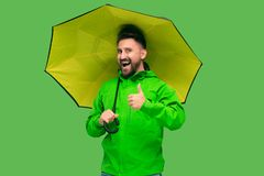 Free Handsome Bearded Young Man Holding Umbrella And Looking At Camera Isolated On White Stock Images - 127912104