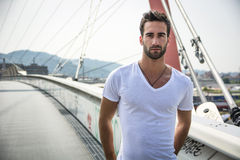 Handsome bearded young man outdoors in urban environment Royalty Free Stock Image