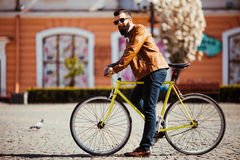 Handsome bearded young man in sunglasses on bike in the city. Bicycle concept Royalty Free Stock Photo