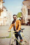 Handsome bearded young man in sunglasses on bike in the city. Bicycle concept Royalty Free Stock Image