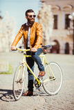 Handsome bearded young man in sunglasses on bike in the city. Bicycle concept Royalty Free Stock Images
