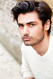Handsome beautiful young man outdoor. Fashion hairstyle Stock Photo