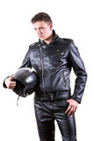 Handsome biker man wearing black leather jacket and pants holding motorcycle helmet. Portrait of handsome biker man wearing black leather jacket and pants Stock Image