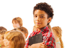 Handsome black boy with notepad and friends Royalty Free Stock Photography