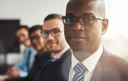 Handsome black business man with three employees Stock Photos