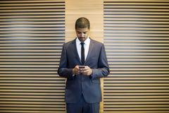 Handsome black businessman Stock Photos