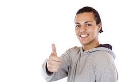Handsome black coloured teenager holds thumb up. Stock Images