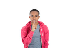 A handsome black guy placing finger on his lips Royalty Free Stock Images