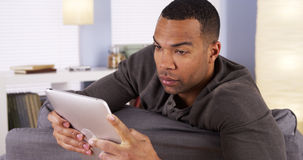 Handsome Black guy using tablet Stock Image