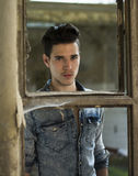 Handsome black haired young man in denim shirt Stock Photography