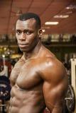 Handsome black male bodybuilder posing in gym Stock Images