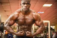 Handsome black male bodybuilder posing in gym Royalty Free Stock Photo
