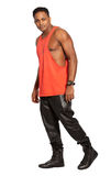 Handsome black man. Full length, on white background. Urban modern style with orange tank top, blacks trousers and black shoes. PNG format available royalty free stock photography