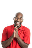 Handsome black man laughing. Handsome black man in his 20s laughing isolated on a white background Stock Image