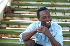 Handsome black man laughing outdoors Stock Photos