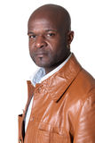 Handsome black man with leather jacket isolated royalty free stock photography