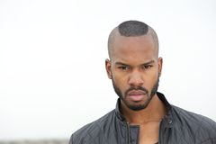 Handsome black man looking at camera Stock Images