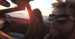 Handsome black man partying with friends while driving in convertible stock video footage