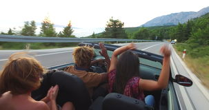 Handsome black man partying with his girlfriend while driving in convertible stock video footage