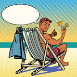 Handsome black man resting on the beach. Pop art retro vector. The man in the recliner. Retro vacation at sea Stock Photo