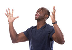 Handsome black man screaming with excitement Royalty Free Stock Photos