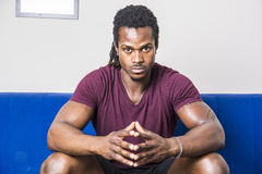 Free Handsome Black Man Sitting On Couch Royalty Free Stock Images - 94824459