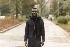 Handsome Black Man Smiling on Park Road