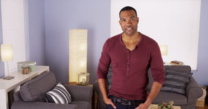 Handsome Black man standing in living room Royalty Free Stock Images