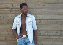 Handsome black man standing outdoors with open shirt Royalty Free Stock Photo