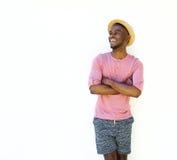 Handsome black man in summer wear. Portrait of a handsome black man in summer wear standing against white background Stock Photo
