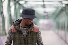 Handsome black man wearing casual clothes. Young man on an iron bridge in a European city Royalty Free Stock Photography