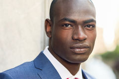 Handsome black man wearing suit in urban background Stock Photo