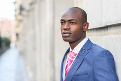 Handsome black man wearing suit in urban background Royalty Free Stock Images