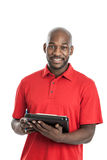 Handsome black man writing on clipboard Royalty Free Stock Image