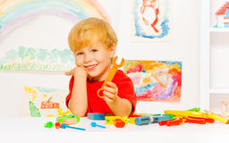 Handsome blond boy with wrench in kindergaten Royalty Free Stock Image