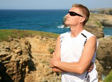 Handsome blond man enjoy Las Catedrales beach Ribadeo Spain Royalty Free Stock Photo