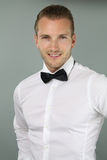 Handsome blond man wearing a bow tie Royalty Free Stock Photos