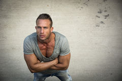 Handsome blond muscular man shot from above, looking up Stock Images