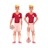 Handsome blond soccer player in uniform standing with football ball Royalty Free Stock Photo