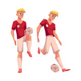 Handsome blond soccer player in uniform standing with football ball Stock Photo