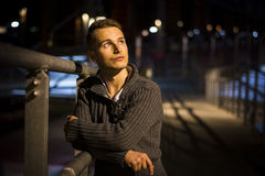 Handsome blond young man alone in urban setting Stock Photos