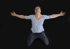Handsome blond young man with arms spread open Royalty Free Stock Image
