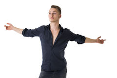Handsome blond young man with arms spread open Stock Images